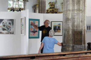 Hanging paintings at the Summer Exhibition